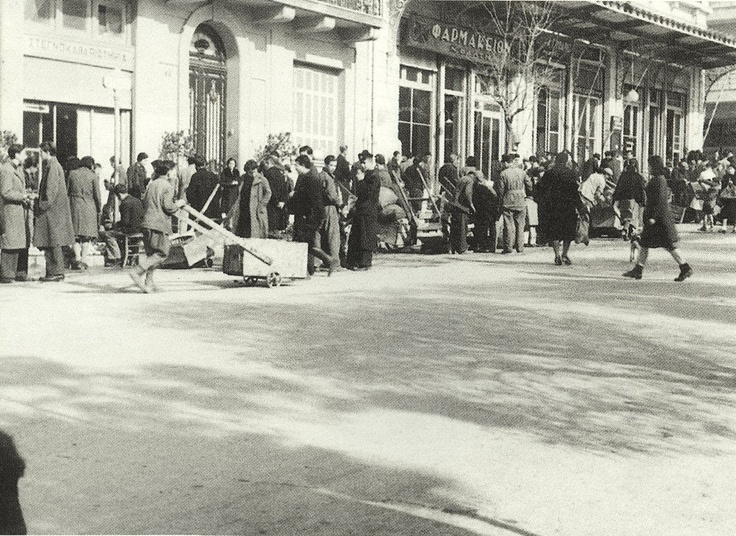 Athens, Greece, winter of 1941-1942. Most of the vehicles are comandeered by the German occupation forces and the usage of public transport is allowed to Greeks only a few hours per day. So most of the people are using wooden transportation carts. Such carts are seen here on Kolonaki sq.