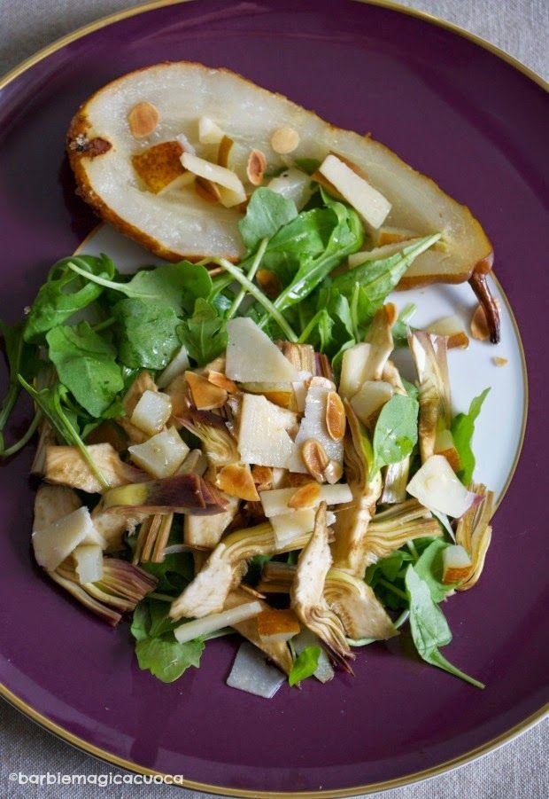 Insalata di carciofi crudi e rucola con scaglie di grana, pere caramellate e mandorle