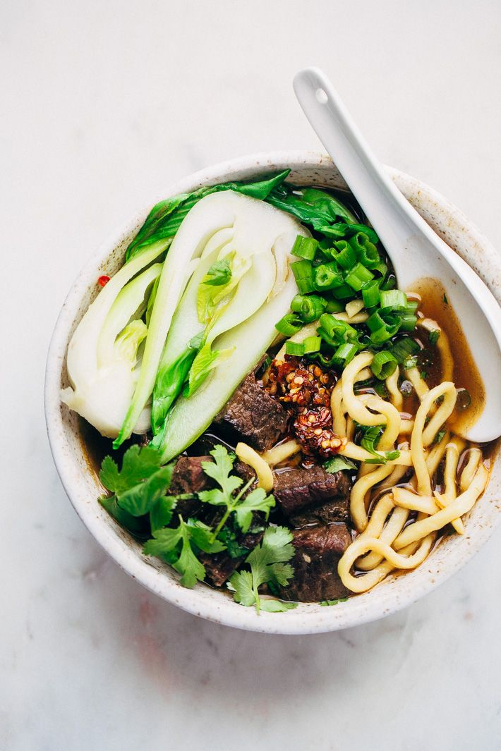 A homemade taiwanese beef noodle soup that's slow simmered and cozy. Loaded with chewy noodles, bok choy, tons of cilantro and hot chili oil! So comfy!
