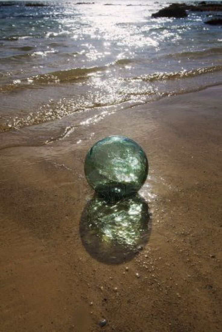Glass float ball drifts to shore on a Pacific island.