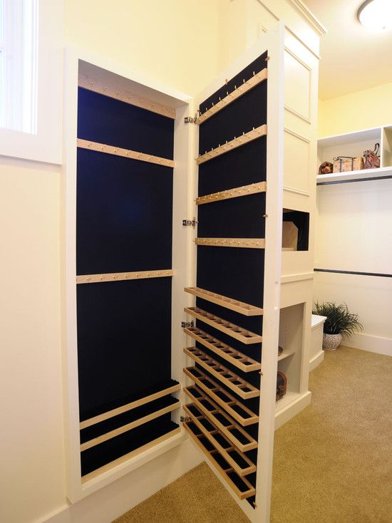 Hidden jewelry closet behind a full length built-in mirror!