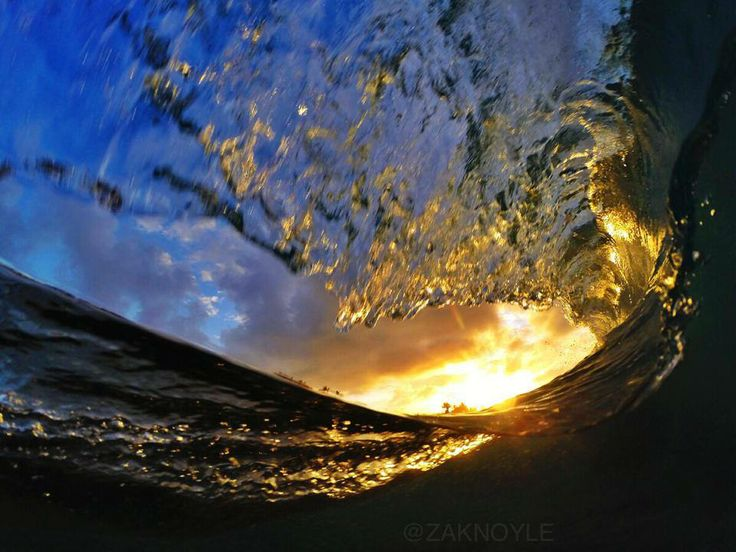 Zak Noyle Photography   -    Morning sunrise split views. Shot at Sandy beach in Hawaii using the all new SPL GoPro housing & 8 inch Dome Port.