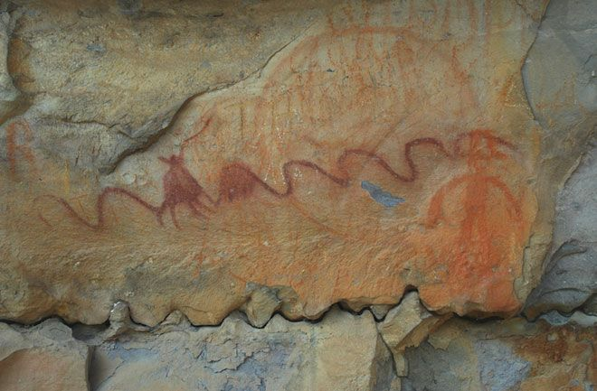 A very large polychrome pictograph depicts humans, serpents and circles. The image is from new discoveries of cave rock art in Tennessee extending into Alabama. It likely illustrated a myth spread across generations via word of mouth...