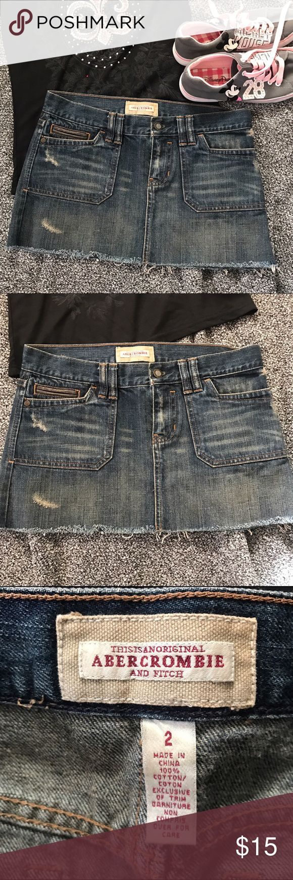 """🆕Abercrombie Distressed Denim Skirt Size 2 Distressed denim mini skirt by Abercrombie and Fitch. Cute decorative brown leather strip and buckle in back. Size 2, waist measurement 15.5"""" across, hip 17.5"""" across, length 10.5"""" waist to frayed edge. Abercrombie & Fitch Skirts Mini"""