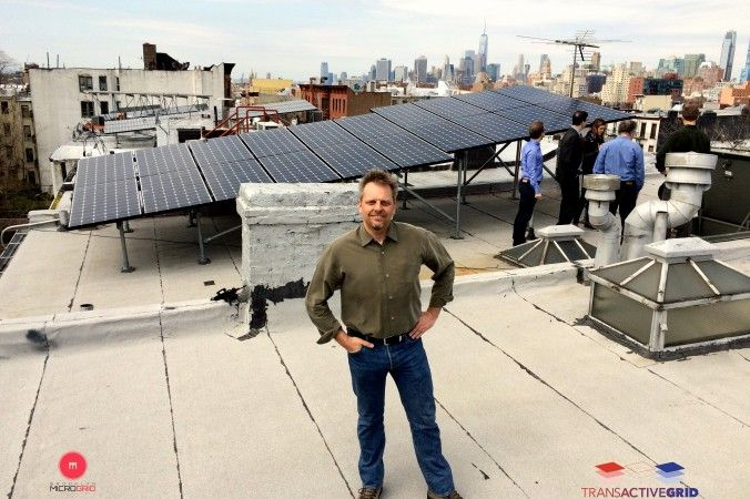 Lawrence Orsini, president and founder of Lo3 Energy, in front of a rooftop solar panel installation on President Street in Brooklyn, New York. (Courtesy of Lawrence Orsini)