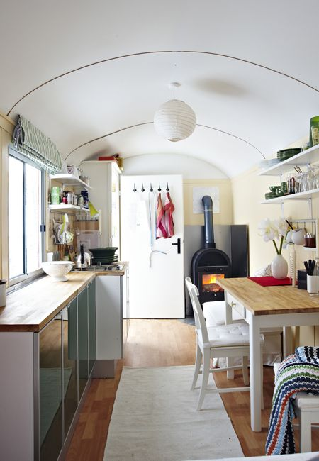 Ikea decorated trailer ... I love the lay-out and the inclusion of a small wood-burning stove!