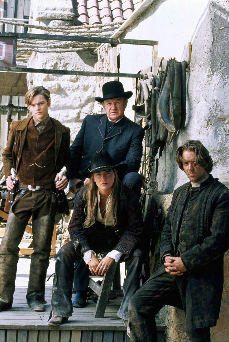 """""""The Quick And The Dead"""" cast photo, 1995.  L to R: Leonardo DiCaprio, Gene Hackman, Sharon Stone, Russell Crowe.  Sony Pictures didn't want to cast two of these actors: Crowe and DiCaprio.  Sharon Stone went to bat for both actors - she chose Crowe and actually paid DiCaprio's salary for this movie!"""