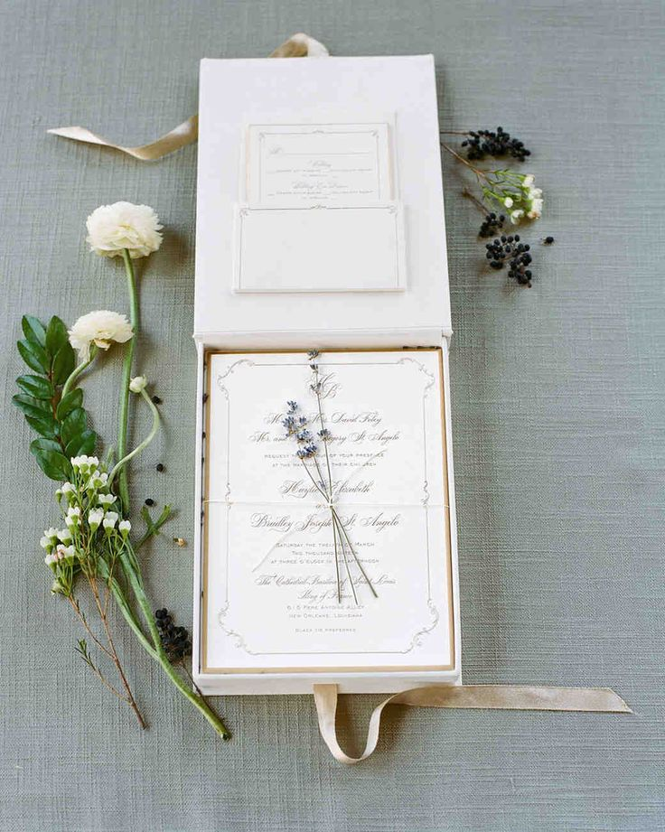An Epic New Orleans Wedding with Classic Touches | Martha Stewart Weddings - Sprigs of lavender topped the engraved and foil-stamped invitation packet, which was mailed in a monogrammed cotton box, all designed by Lehr & Black.