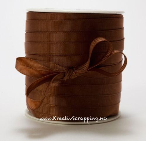 MAY ARTS - RIBBONS NYLON 3/8 - SX33 - BROWN MAY ARTS-Grosgrain Ribbon. This solid colored ribbon is a good addition to a present, a floral arrangement, or other project. This package contains one 3/8 inch.Available in a variety of designs, each sold separately.