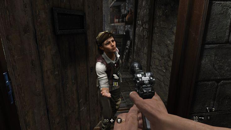 Wolfenstein: Old Blood. Německá vesničanka ke mně natahuje roku. Já jí tou svou virtuální sahám na prsa. Omylem.