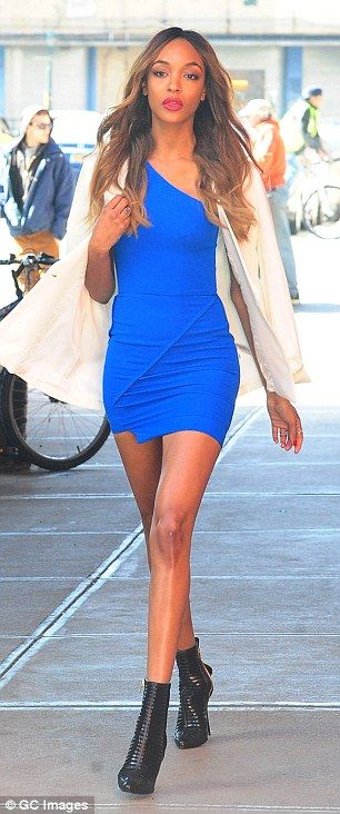 Legs for days: The 25-year-old model flaunted her impossibly long legs in a thigh-skimming blue mini-dress, which had an asymmetric hemline