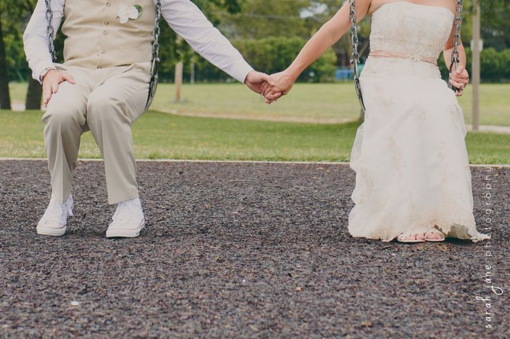 Bride and Groom on swings at a park