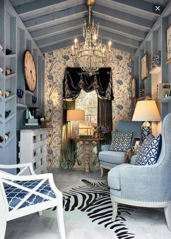 So many beautiful she-sheds... this one might be my favorite! Luxurious yet comfortable outdoor decor furnishings for an enclosed porch or anywhere that is safe from weather related destruction. Such an inspiring She-shed idea!