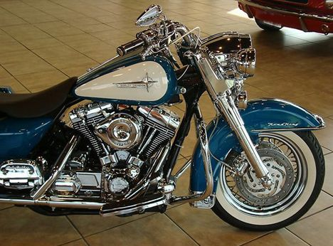 Photo of 2001 Harley Road King motorbike with teal and white retro look custom paint job.