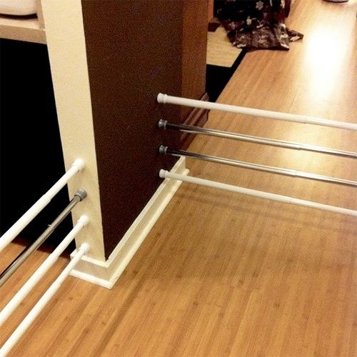 Use tension rods instead of buying gates for pets_can use for other things later after not needing for pets anymore.