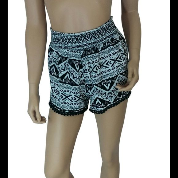 "Aztec Print Shorts #423-L Black / Ivory Aztec print shorts. 100% rayon. Made in USA. Waist measured laying flat is 25"" and it is elastic so it will stretch out 5-6"" more. Hips are about 42"" and length 16"". My Beloved Shorts"