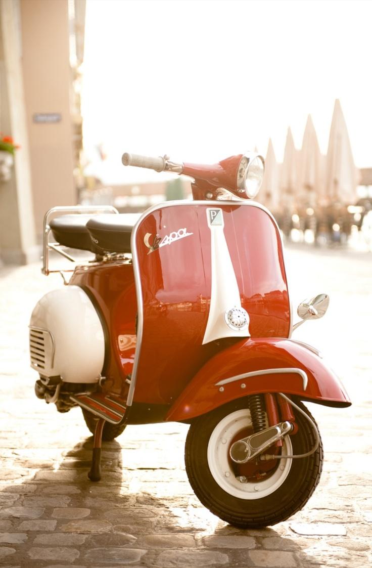 Cute red vintage vespa ride around in italy
