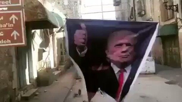 WTF just know injustice can no longer hide  @Regrann from @crackedrosecoloredglasses_us -  #Repost @eddied77  @Regrann from @eye.on.palestine -  Palestinians throwing shoes at #Trump in the closed street of Shuhada in Hebron . LMAO . القاء الاحذية على صورة للرئيس الامريكي ترامب في شارع الشهداء في الخليل . . By @mosab.shawer . .- #regrann  #CNN #ABC #CBS #NBC #FoxNews #BBC HEBRON (Maan) -- Israeli forces on Friday suppressed a crowded march in the Old City of the southern occupied West Bank…