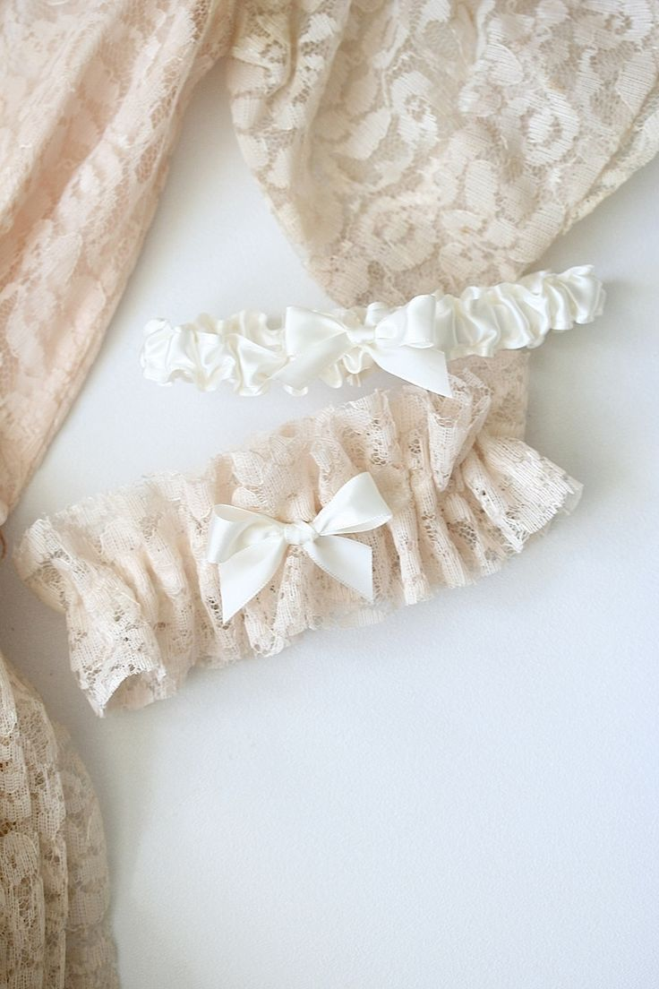 BLUSH LACE CUSTOM WEDDING GARTER MADE FROM GRANDMOTHER'S WEDDING DRESS  The Garter Girl provides handmade, heirloom quality, one of a kind wedding garters. Click to shop. Free US Shipping. Copy and paste  https://thegartergirl.com/10offfor30/ in your browser for a 10% off coupon.    #garter #weddinggarter #tooprettytotoss #heirloom #familyheirloom #gartergirl #bride #lace #weddingdress
