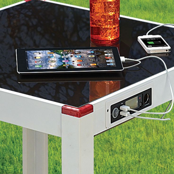 The Device Charging Patio Table - Hammacher Schlemmer.... no longer available but would be cool!!!  Solar Power!!