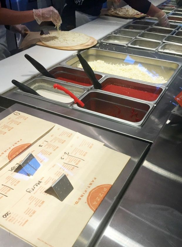 Building your pizza at Blaze Pizza in Calgary. Our thoughts and restaurant review!