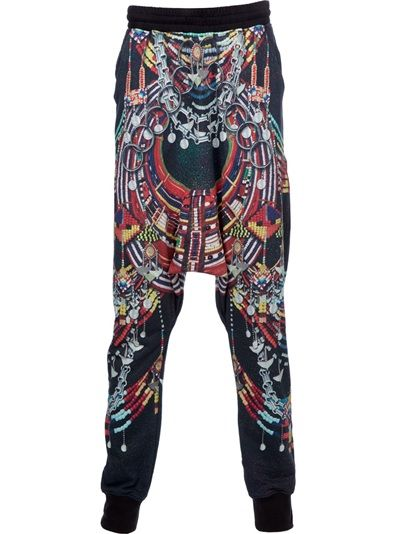 Black cotton trousers from Kokon to Zai featuring a drawstring ribbed waistband, multi-colour bead print design, a drop crotch, wide thigh area and a skinny lower leg.