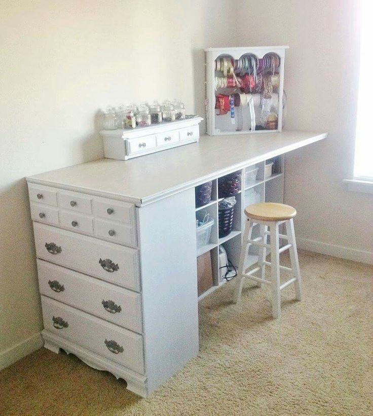 Old dresser turned into craft table.                                                                                                                                                      More