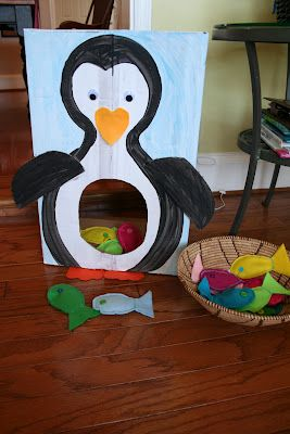 Penguin bean bag toss with fish bean bags.  A great way to use one of those boxes you get from Costco.
