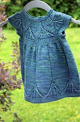 Baby vest or dress. Pattern in Danish or English. Available as kit only from Isager. You may be able to find the pattern sold separately at your LYS or online.
