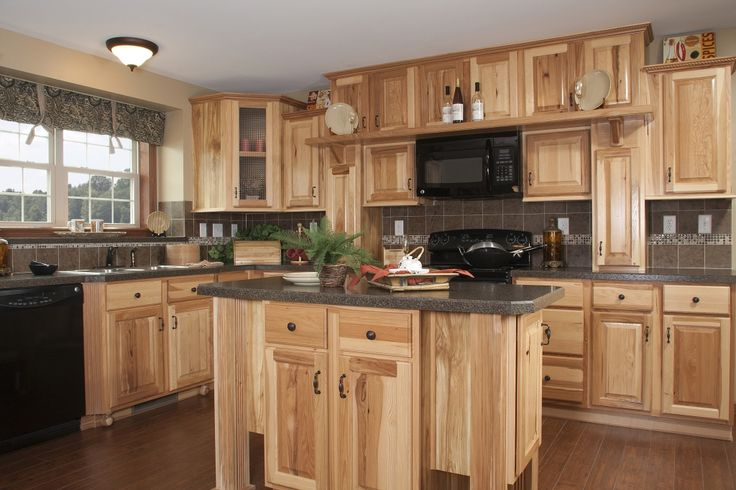 Kitchen in the Manhattan HR137A - Pennwest Ranch Modular. Hickory cabinets, large island, black appliances, and much much more!