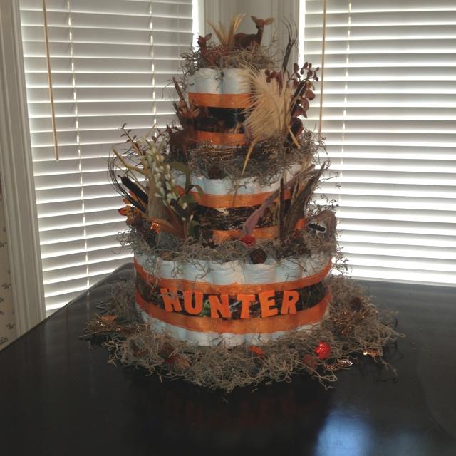 Camo & orange diaper cake :)......love the deer, it needs a duck too!