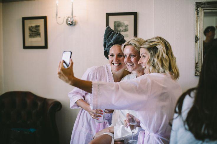 Bride and bridesmaid taking a photo