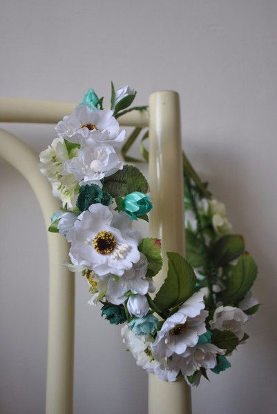 Hand-made flower crown.  The crown is open-ended and can be tied on the back with a ribbon.  Materials: florist wire, floral tape, fabric flowers.  This item is ready to be shipped!