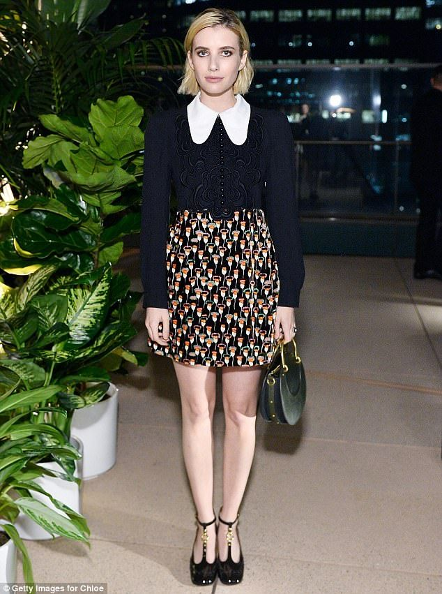 Stylish: Emma, 26, chose a colorful collared mini dress, complete with a textured floral detail along the torso
