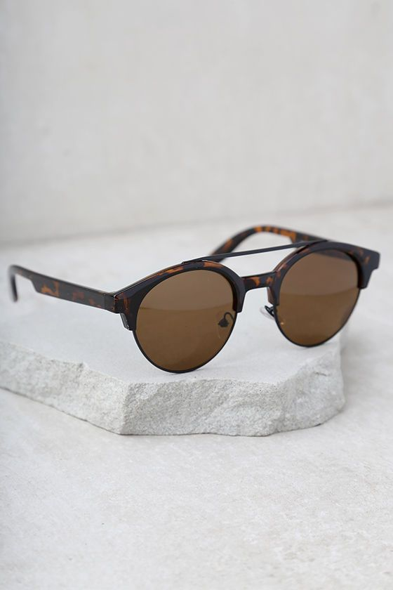 Youll be perfectly put together with the Neat Tortoise Sunglasses! Brown tortoise frames surround, round brown-tinted lenses. UV 400.