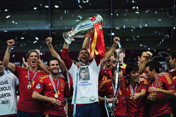 JULY 1: EURO THRASH -- Sergio Ramos, centre, of Spain celebrates with his team-mates after the UEFA EURO 2012 final match between Spain and Italy at the Olympic Stadium in Kiev, Ukraine. The defending Euro and World Cup champions clinch their third straight major international title. (Photo by Shaun Botterill/Getty Images)