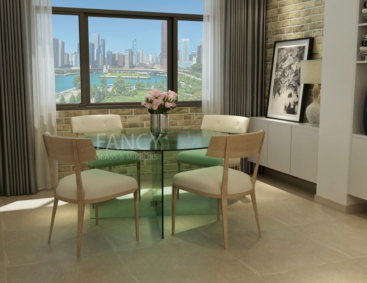 This OSCAR CIRCLE DINING TABLE is designed to meet all security demands and to be a centerpiece of any dining room. The glass table top is made of thick tempered glass and the base is formed from the same glass, what makes it seamlessly incorporated in the general look. The base glass panels are fixed together with the help of Traditional Style Glass-to-Glass Clamp. Clamp design allows for adjoining panels to meet with a minimal gap. This glass dining table is available in different size.