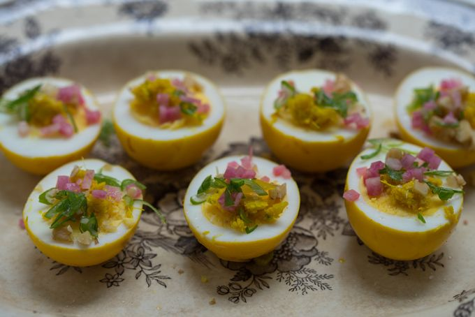 Pickled Turmeric Eggs - If you've got hard-boiled eggs and five extra minutes, you can make these beauties! They're the best. Hard-boiled eggs pickled in turmeric, shallot, and apple cider vinegar - beautiful, quick to make, and delicious. - from 101Cookbooks.com