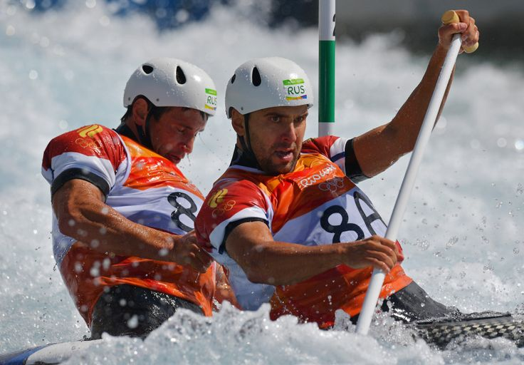 Russia's Dmitry Kuznetsov (R) and Dmitry Larionov compete in the Men's C2 semifinal canoe slalom competition at the Whitewater stadium during the Rio 2016 Olympic Games in Rio de Janeiro on August 11, 2016.        (Photo: CARL DE SOUZA/AFP/Getty Images)