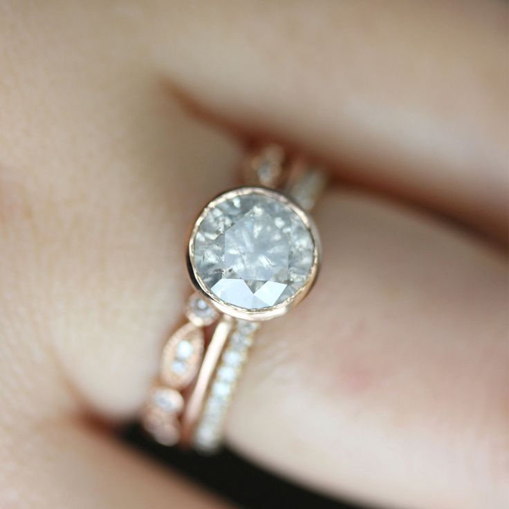 I kind of like the idea with the 3 different bands, White - Gray Diamond in 14K Rose Gold Engagement Ring - Ready to Ship. $1,550.00, via Etsy