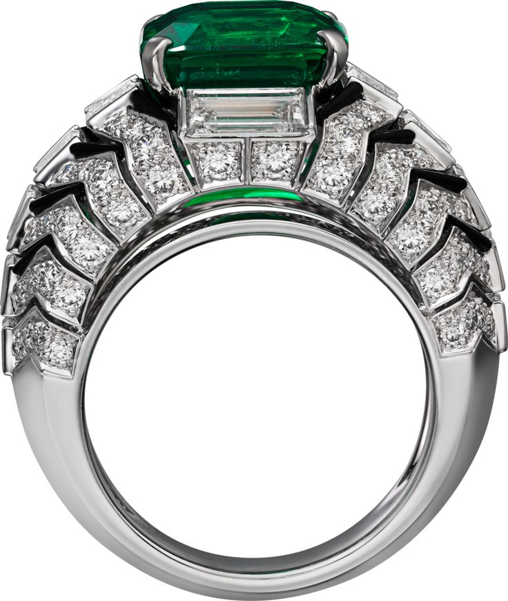 "Cartier. ""Oracle"" Ring - platinum, one 6.53-carat rectangular-shaped round-cornered step-cut emerald from Colombia, onyx, baguette-cut diamonds, brilliant-cut diamonds. Cartier Magicien"