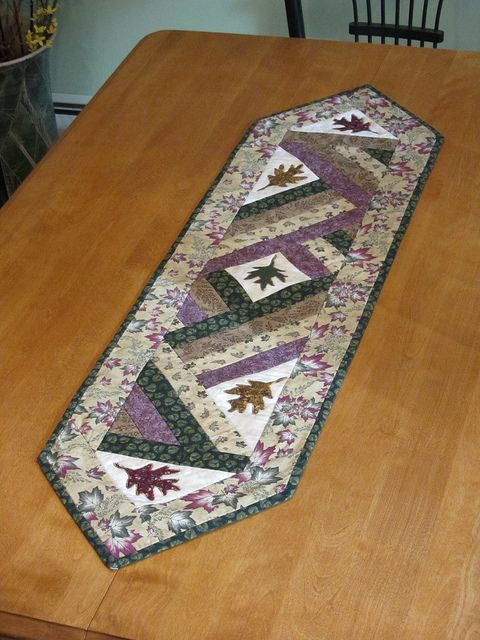Fall Table Runner ~ love how this turned out. No specific pattern, but it repeats itself on both side. The leaf appliques adds the effect of the season. Nice as this can be changed to any season...