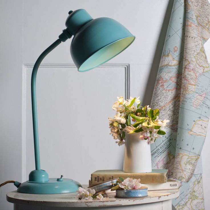 Dream of travelling the world by sea with our newly launched #cartography fabric made by Jim Lawrence. Continue the theme with accents of #blue as we have done with the Newark Desk Lamp in a gentle Duck Egg Blue.