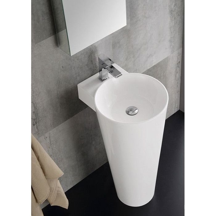 """Brighten your bathroom or powder room with the contemporary Lucido 16"""" Messina Pedestal Modern Bathroom Sink with Medicine Cabinet. This elegant bathroom duo features an elegant glossy white pedestal sink with an acrylic finish and single faucet mount. To complement the pedestal sink is a Fresca wide bathroom medicine cabinet with mirrors. The rectangular medicine cabinet has a contemporary frameless design. 2 Adjustable glass shelves within the cabinet can accommodate items of varying h..."""