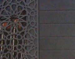 Entrance door design with an geometric design that is laser cut from a single sheet of aluminium.
