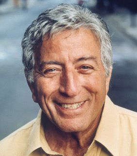 """Anthony Dominick Benedetto (born August 3, 1926), known as Tony Bennett, is an Italian-American singer of popular music, standards, show tunes, & jazz. He was drafted into the US Army in 1944, during the final stages of World War II.As March 1945 began, he joined the front line and what he would later describe as a """"front-row seat in hell.""""  At the war's conclusion he was involved in the liberation of a Nazi concentration camp. He was discharge from the Army and return to the States in 1946."""