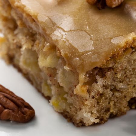 Apple Cake Recipe   Key IngredientIngredients  1 c vegetable oil  2 c sugar  3 eggs  3 c flour  1 tsp baking soda  2 tsp vanilla extract  1 c chopped pecans  3 c peeled and chopped apples   Frosting  ½ c butter  1 c brown sugar, packed  ¼ c evaporated milk  ½ tsp vanilla