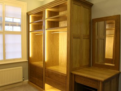 Solid oak, walk-in wardrobes along with dressing table, incorporates LED lighting & Dovetail soft close drawers