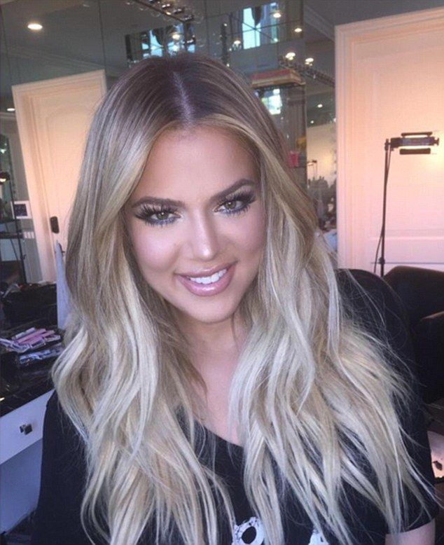 Meanwhile: In between supporting her sister Khloe Kardashian managed to fit in getting a glam new look on Friday - she captioned the shot 'glammed to the heavens'