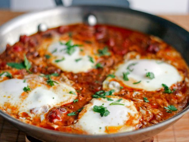 Those who are down with tomatoes and eggs might love this Moroccan-inspired twist on the classic Eggs in Purgatory. Not happy with a boring tomato sauce, the recipe amps up the flavor with merguez sausage, fire-roasted tomatoes, and a hit of complex spices.
